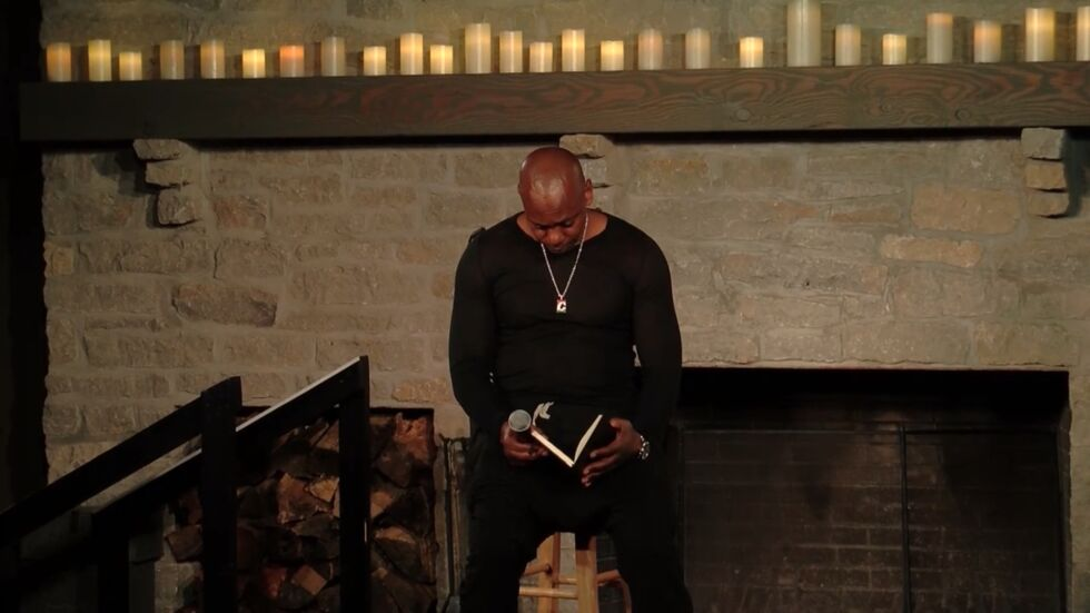 Chappelle checking his reference notes.