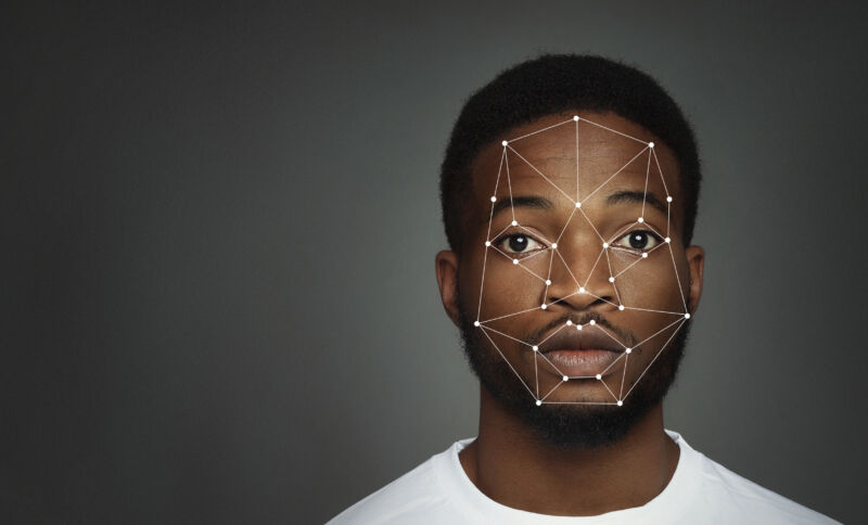 A computer has drawn lines and points on a photograph of a young Black man.