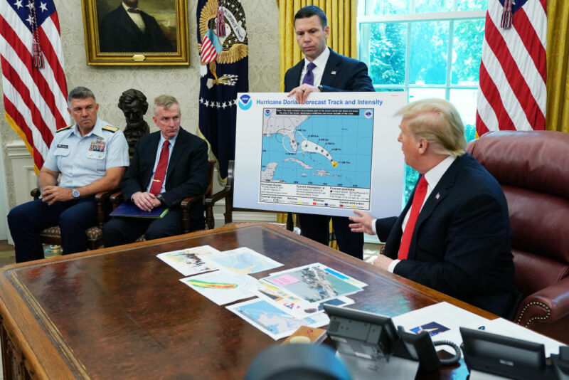 President Trump points to a map that has undergone some post-printing modifications.