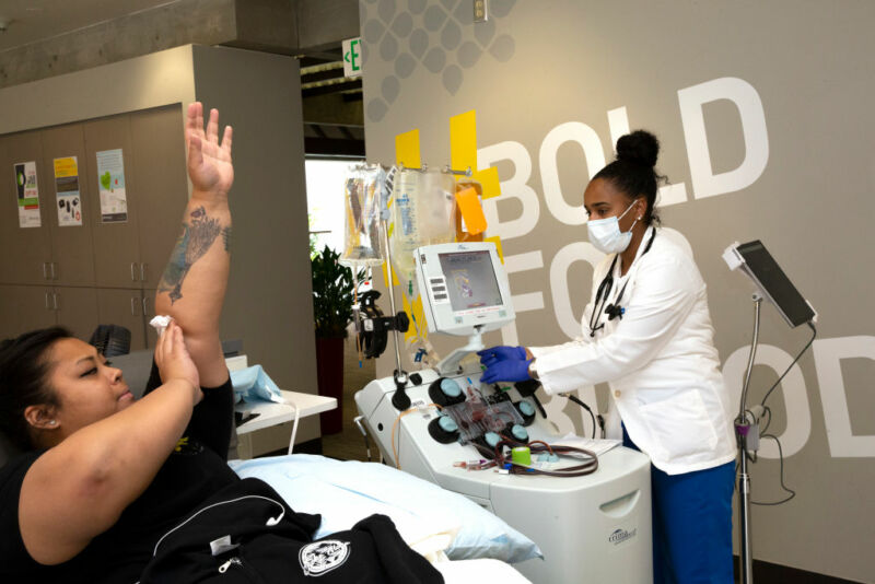 Image of a woman finishing a blood donation.