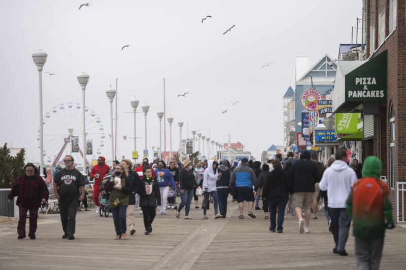 Crowds of people walk along the Ocean City Boardwalk during Memorial Day weekend on Sunday, May 24, 2020.