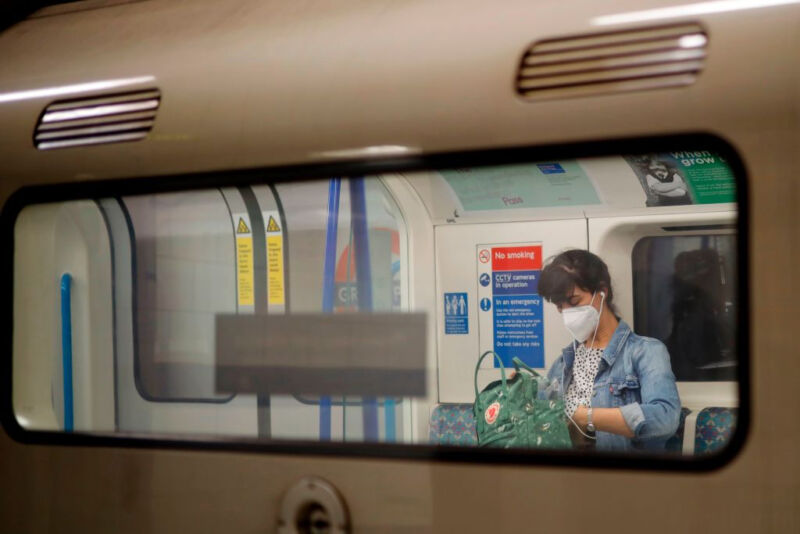 Image of a masked person on a commuter train.