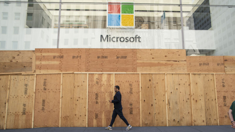 "Ironically, this boarded-up Microsoft Store location in New York City, seen on June 8, is one of the four in the world that <em>will</em> reopen—but as an ""experience center"" where you can't buy anything."