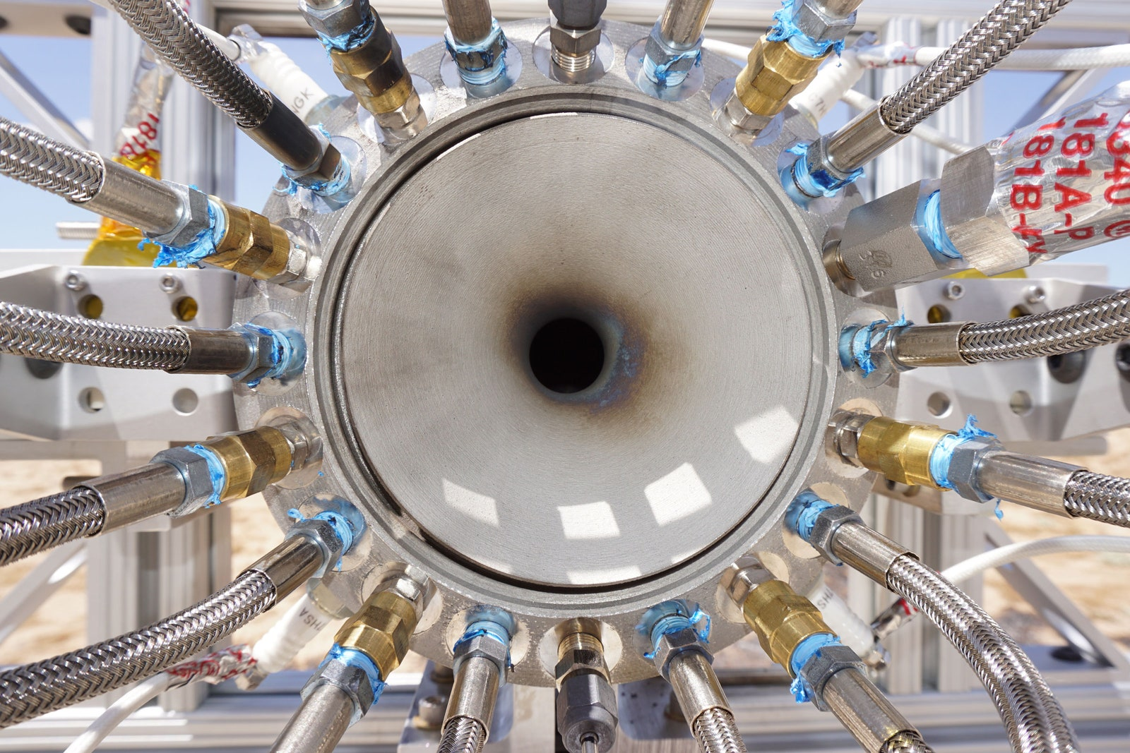 The air intake on Mountain Aerospace Research Solution's Fenris engine after its first hotfire last July. The lines around the cone feed kerosene and gaseous oxygen into a combustion chamber, where it is mixed with the air and ignited.