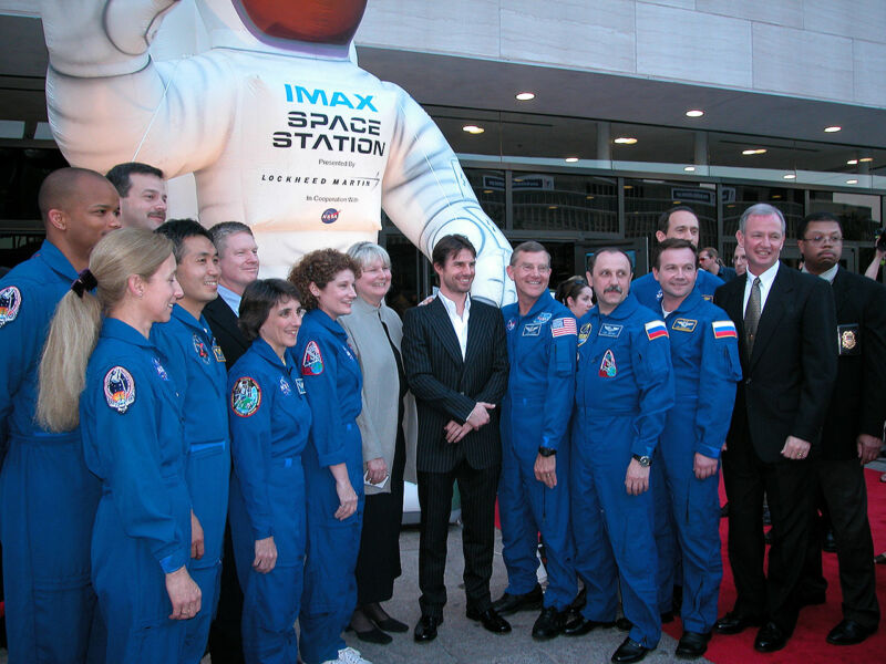 Tom Cruise, at center, poses with NASA astronauts at the 2002 premiere of the IMAX film <em>Space Station 3D</em> at the National Air and Space Museum in Washington, DC. From left to right: Robert Curbeam, Marsha Ivins, Koichi Wakata, Scott Altman, Nancy Currie-Gregg, Bill Shepherd, Susan Helms, IMAX producer Toni Myers, James Voss, Yuri Usachov, Yuri Lonchakov, Jim Newman and Brian Duffy.
