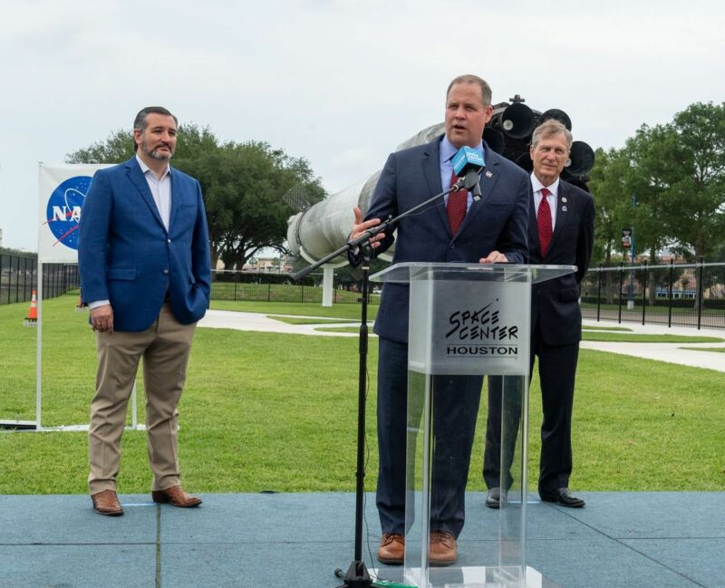 Sen. Ted Cruz, NASA Administrator Jim Bridenstine, and US Rep. Brian Babin stand in front of a flight-proven Falcon 9 rocket at Space Center Houston on Sunday.