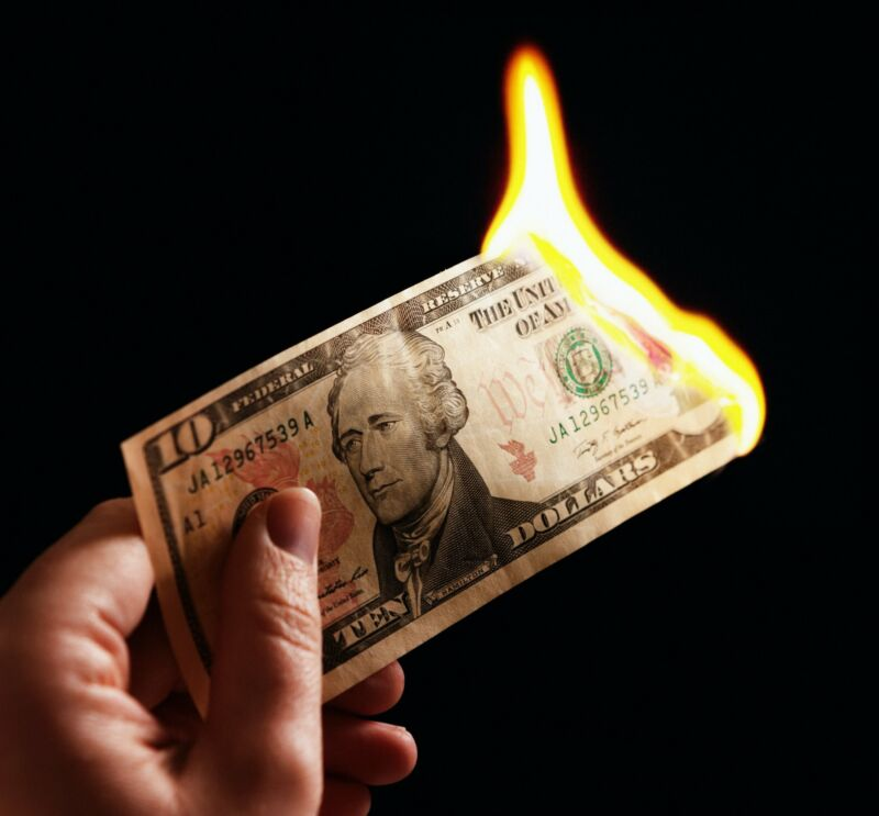 Illustration of a $10 bill on fire.