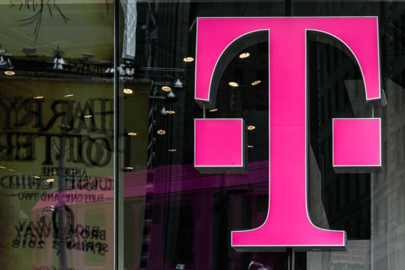 A T-Mobile logo on the window of a store.