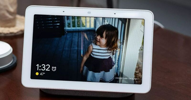A smart home security device displays an image of a child on a porch.