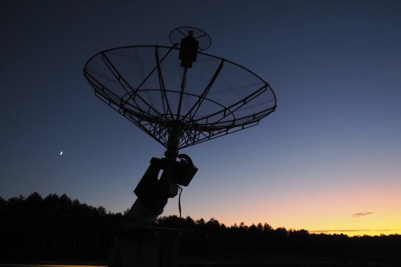 The moon is seen behind an antenna on the site of the radiotelescope of Nancay on October 03, 2019, near Vierzon, Central France.