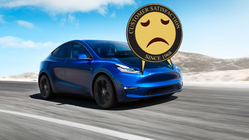 A frowny face has been photoshopped onto a Tesla speeding down a road.