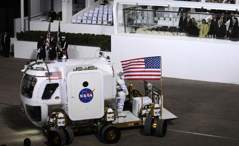 President Barack Obama, Michelle Obama and Vice President Joe Biden watch as the NASA Lunar Electric Rover stops in front of the presidential reviewing stand on Pennsylvania Avenue on Tuesday, Jan. 20, 2009.