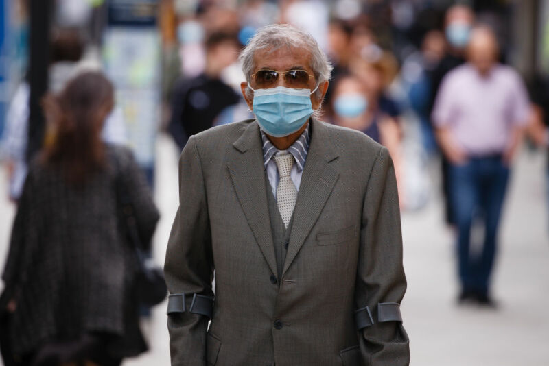 An elderly gentleman wearing a face mask.