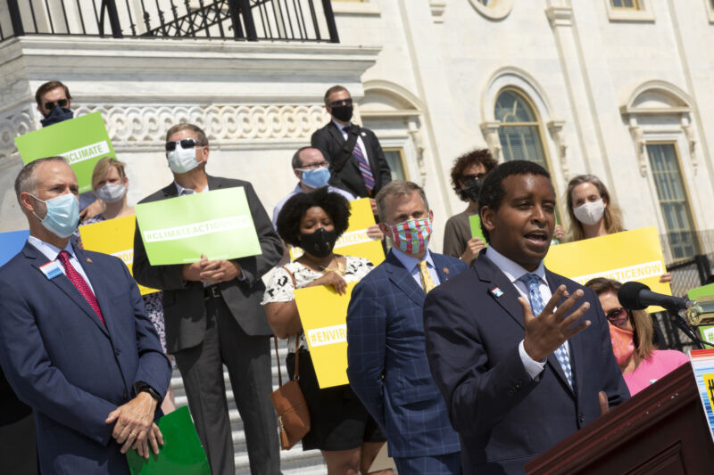U.S. Rep. Joe Neguse (D-CO), joined by members of the Select Committee on the Climate Crisis, delivers remarks during a news conference outside the U.S. Capitol on June 30, 2020 in Washington, DC.