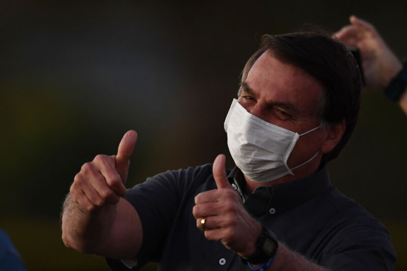 Brazilian President Jair Bolsonaro gives the thumbs up to supporters from the Alvorada Palace in Brasilia, on July 20, 2020, amid the new coronavirus pandemic. (Photo by EVARISTO SA / AFP) (Photo by EVARISTO SA/AFP via Getty Images)