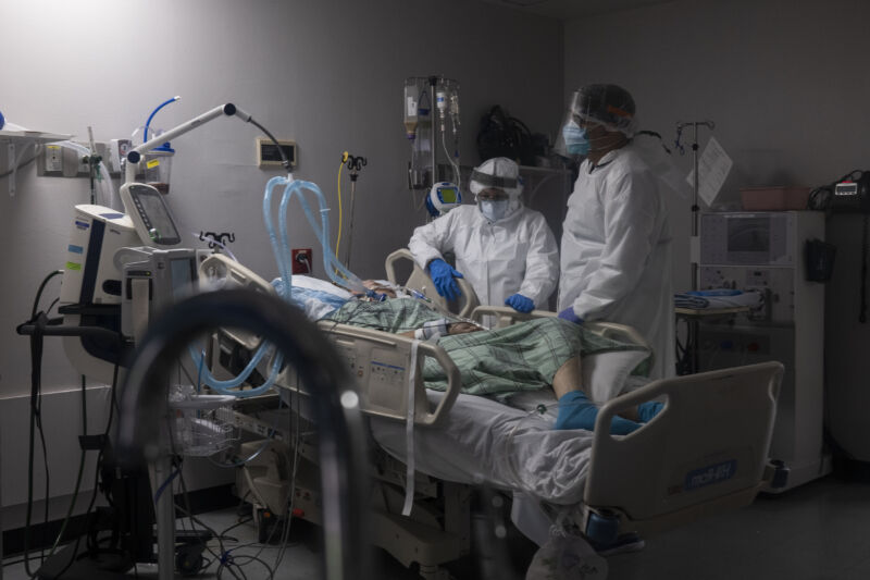 Members of the medical staff treat a patient in the COVID-19 intensive care unit at the United Memorial Medical Center on July 28, 2020 in Houston, Texas. COVID-19 cases and hospitalizations have spiked since Texas reopened, pushing intensive-care units to full capacity and sparking concerns about a surge in fatalities as the virus spreads.