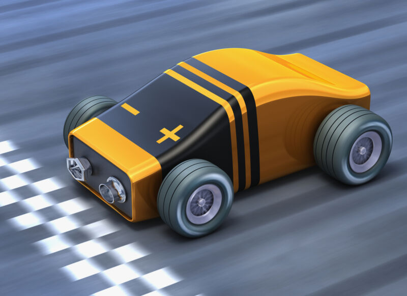 A cartoon race car appears to be made out of a comically shaped 9-volt alkaline battery.