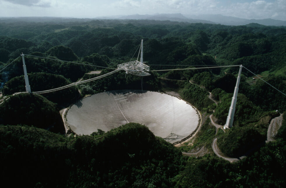 The Arecibo Radio Telescope on Puerto Rico receives interplanetary signals and transmissions. And it was in the movie Contact!