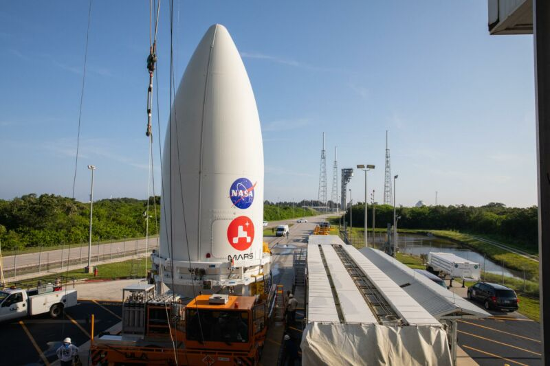 The first stage of the rocket is being transported outdoors.