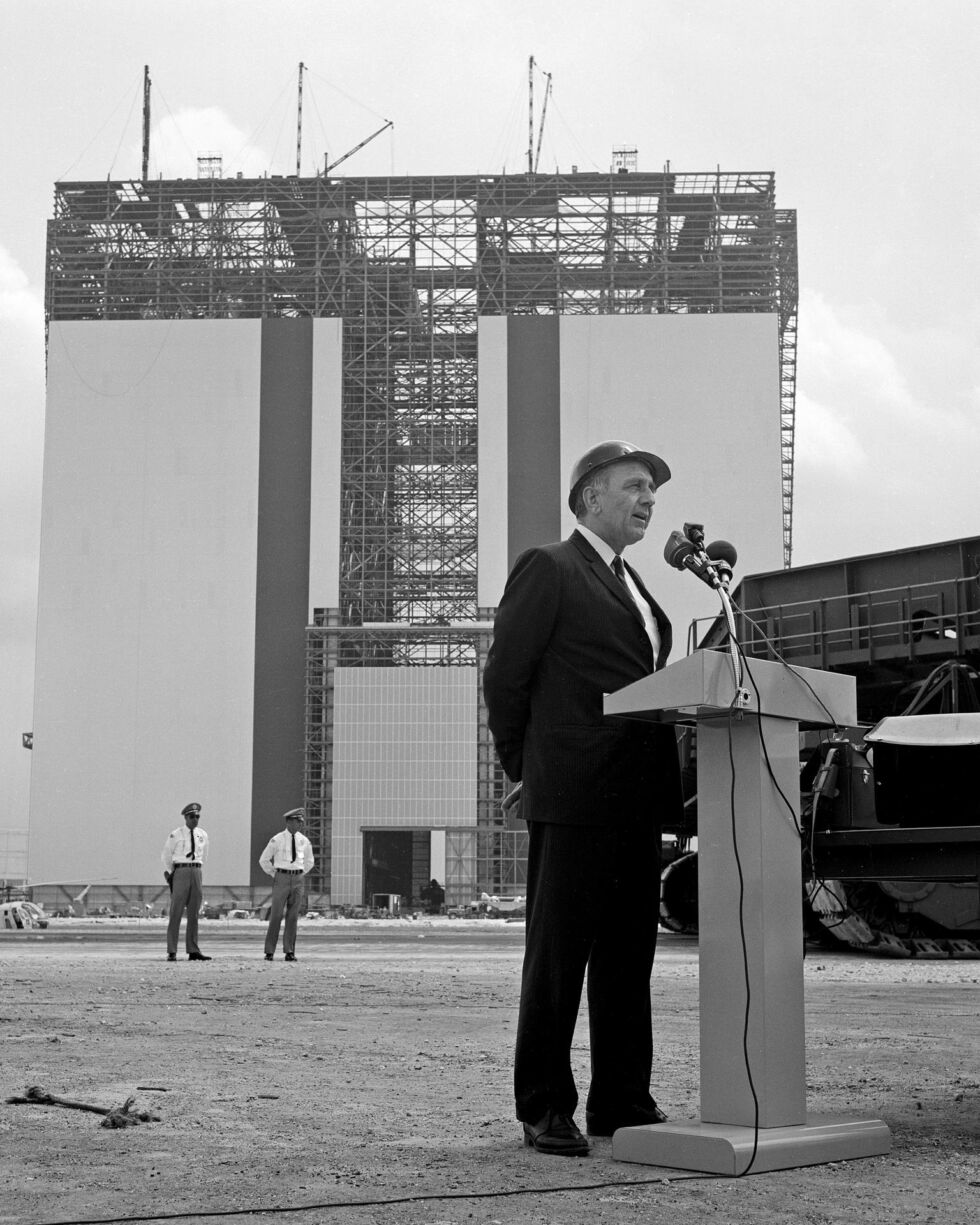 "Center Director Kurt Debus speaks at the ""topping off"" ceremonies for the Vehicle Assembly Building in 1965."