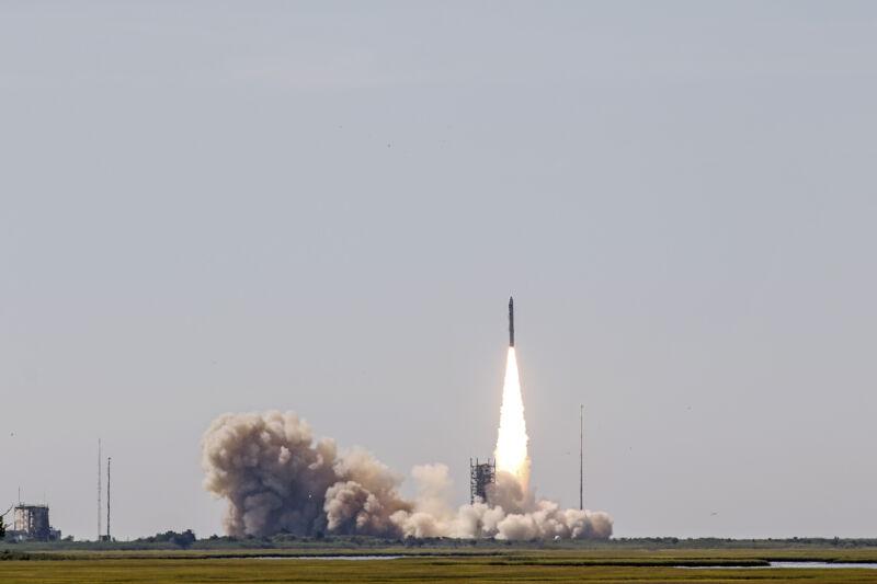 Smoke billows behind a rocket as it lifts off.