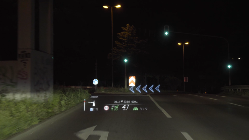 An example of what the Mercedes-Benz augmented reality HUD looks like in action. You can see here it's showing the driver they need to take a left turn.
