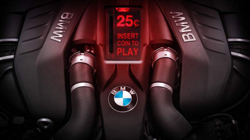A BMW-branded engine has been photoshopped to include an arcade game-style coin slot.