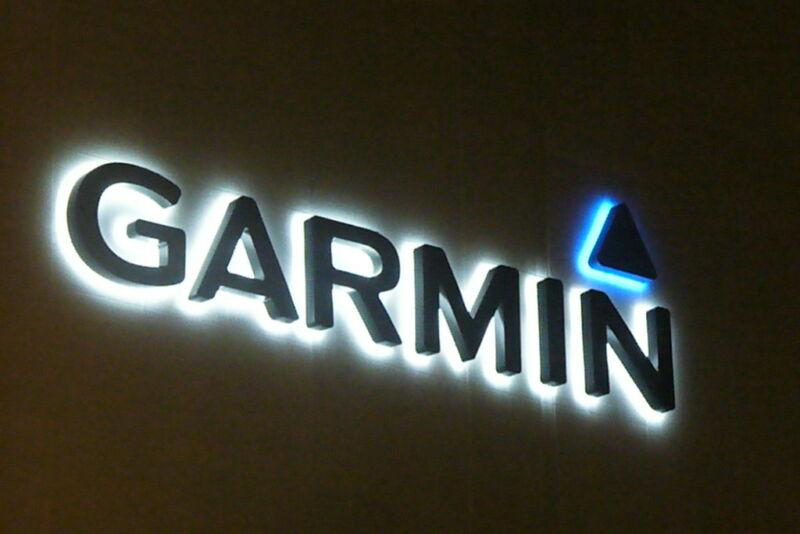 Garmin logo on an dark wall.