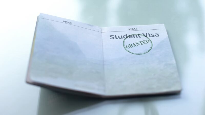 A student visa stamped with the word