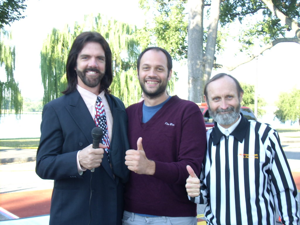 Mitchell (left) and Twin Galaxies founder Walter Day (right) pose with a fan.