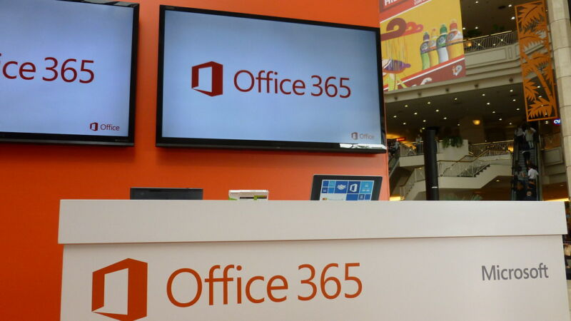 The Office Three 65 logo is emblazoned on TVs and boxes in a shopping mall.