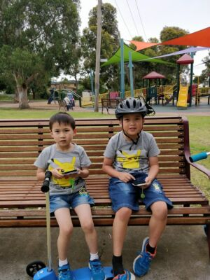 Two young <em>Pokémon Go</em> players that are likely not playing in the park these days.