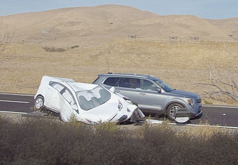 A test vehicle collides with a dummy car at a AAA test track in California.