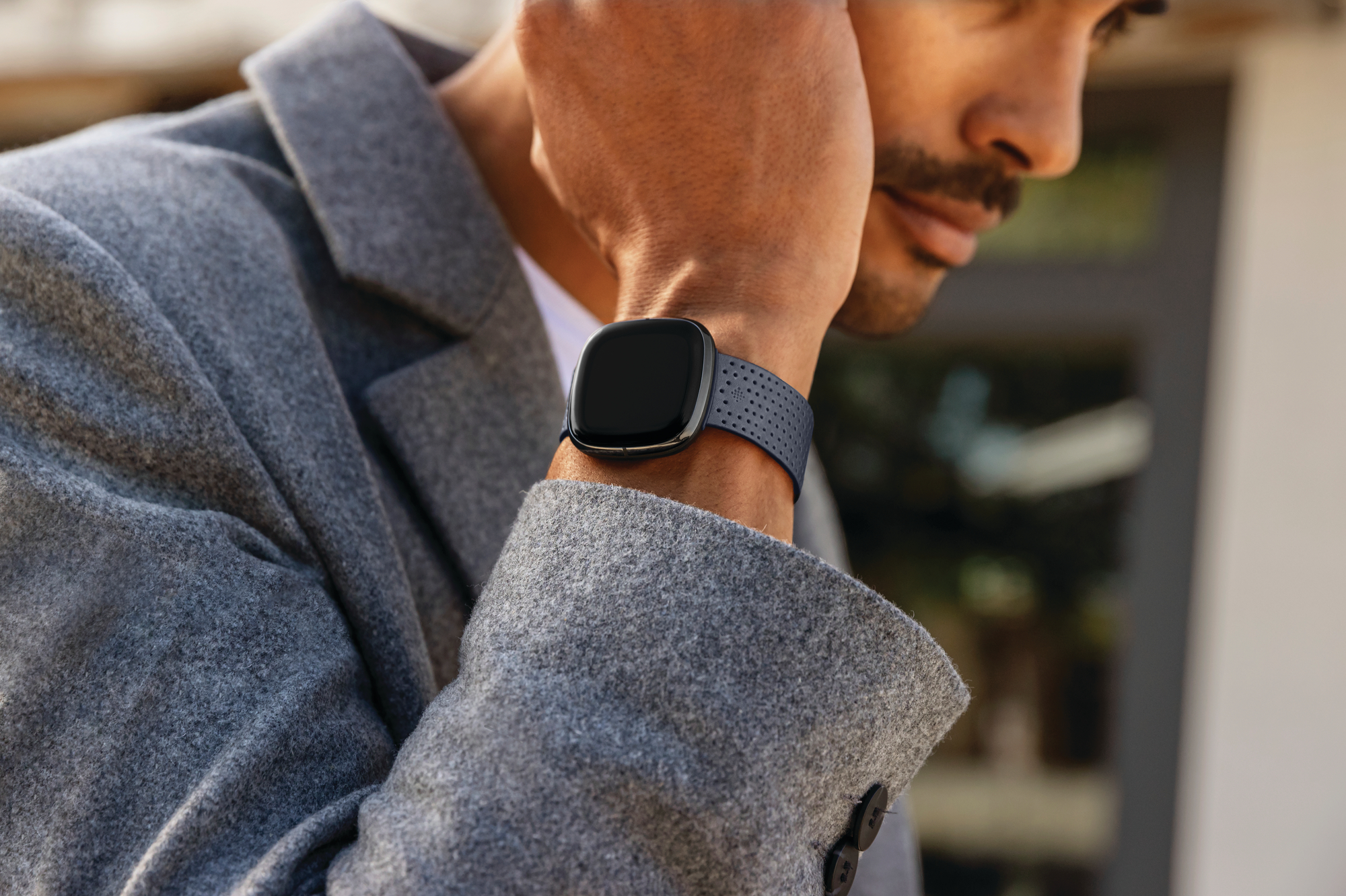 Lifestyle photo of Fitbit Sense.