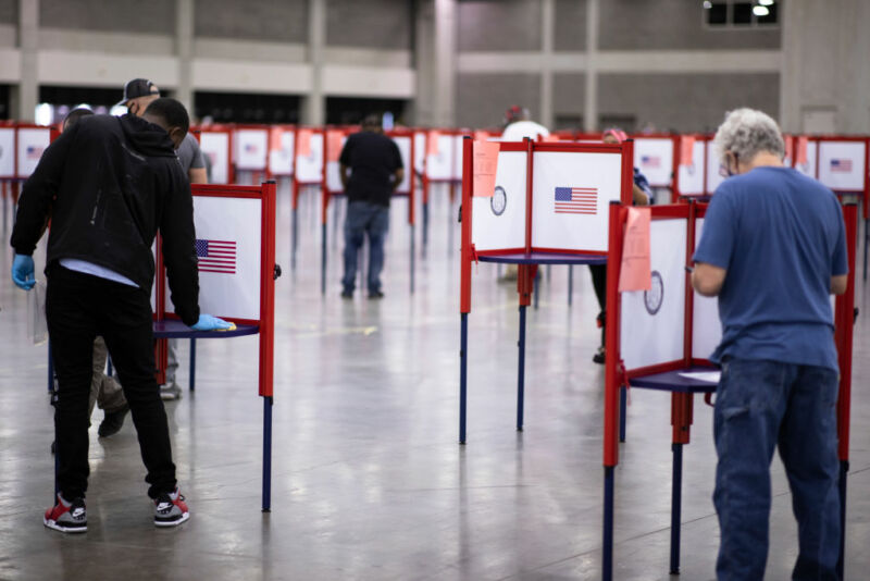 Image of widely spaced voting booths.
