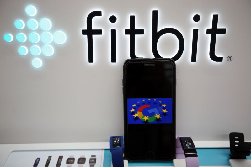 Logo of Google is displayed on a smartphone by logo of Fitbit in Brussels, Belgium on August 4, 2020.