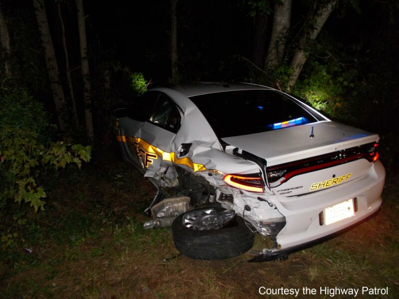 A law enforcement vehicle damaged in Wednesday's crash.