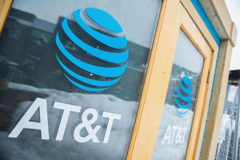 AT&T logos seen on the window and door of a building.