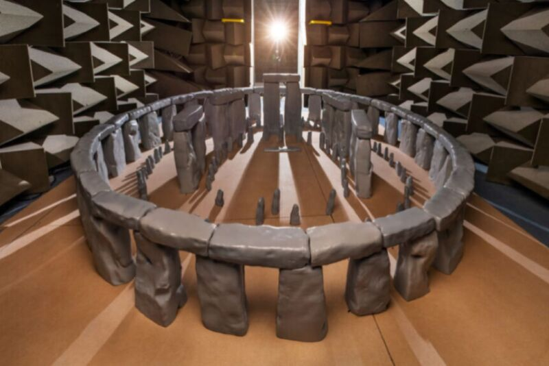 Adorable scale model of Stonehenge inside a large room.