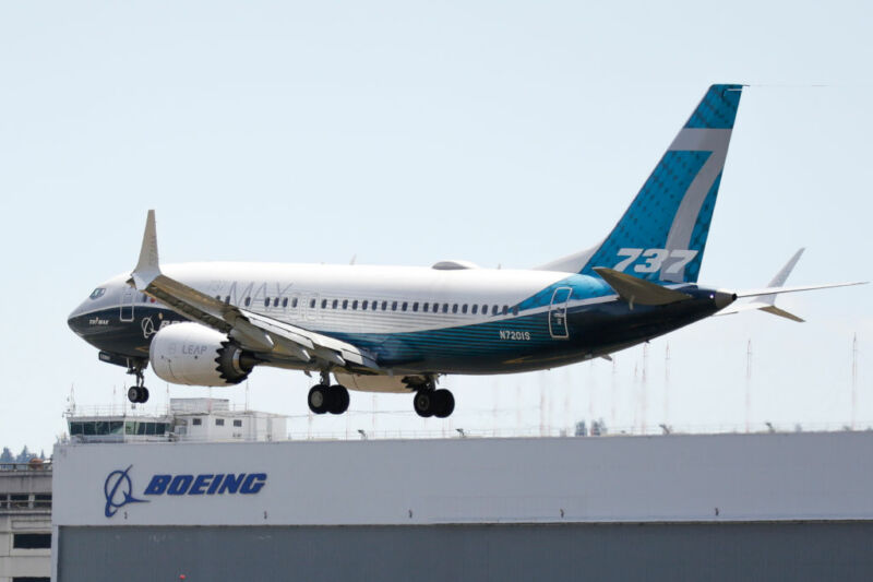 A Boeing 737 MAX jet lands following a Federal Aviation Administration (FAA) test flight at Boeing Field in Seattle, Washington, on June 29, 2020.