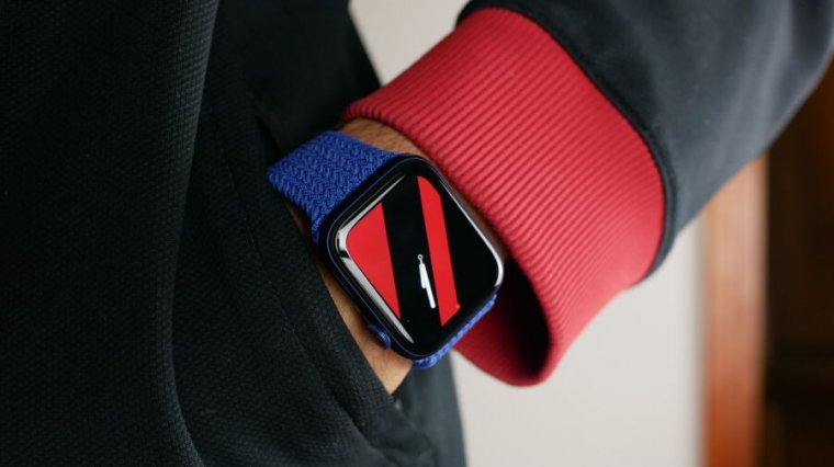Apple Watch Series 6 on a reviewers wrist, showing the striped watch face
