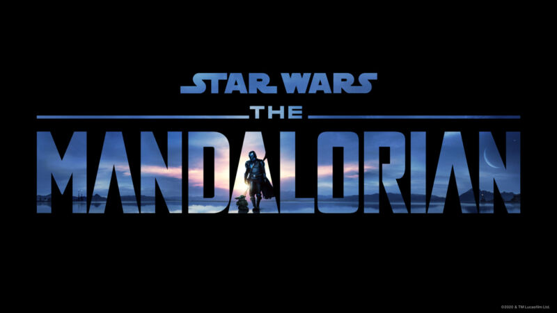 Characters walk in an extraterrestrial sunset outlined by the word Mandalorian.