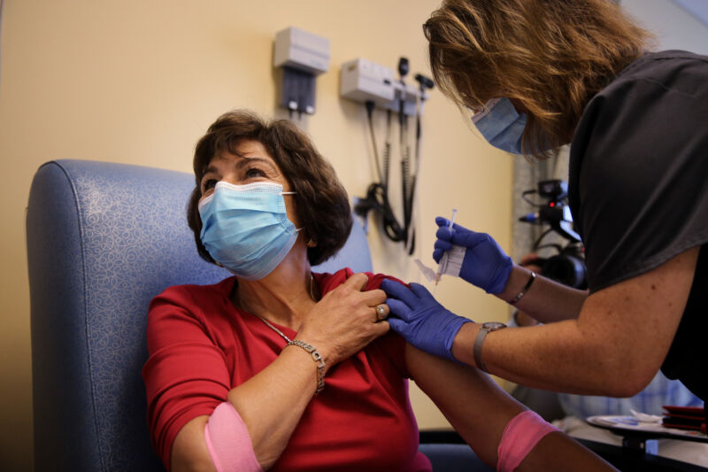 Woman receives an experimental COVID-19 vaccine at the University of Massachusetts Medical School in Worcester, MA on September 04, 2020, as part of a clinical trial.