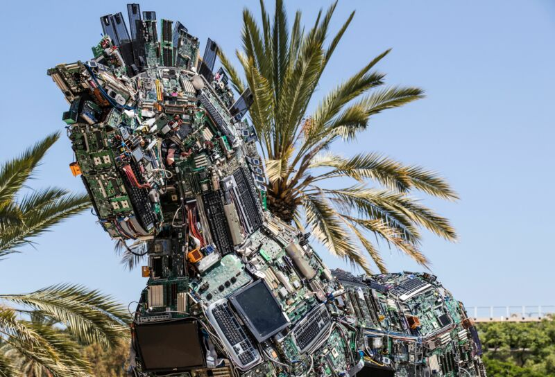 "A replica of the Trojan horse made up of thousands of computer and mobile phone components infected with various viruses and malware, named the ""Cyber Horse"" is displayed at the entrance to the annual Cyber Week conference at the Tel Aviv University in the Israeli city of Tel Aviv on June 20, 2016. The Cyber Horse is a piece of art composed of devices that can be harmed by malware and was created in order to prompt national and international awareness of the dangers of cyber-attacks."