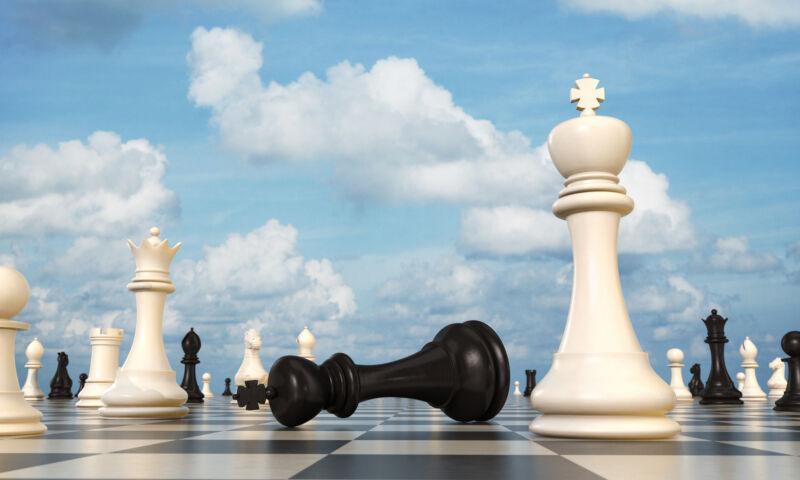 Chess board, black king lying beside white king