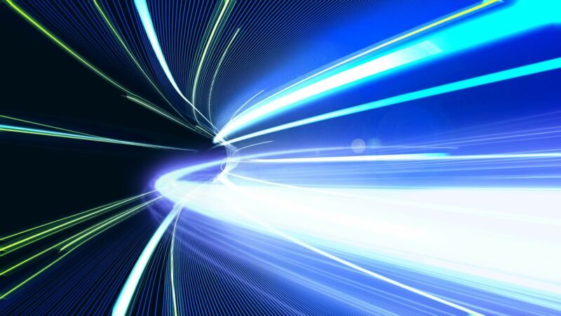 Illustration of lasers flowing down a tunnel to represent fast broadband speeds.