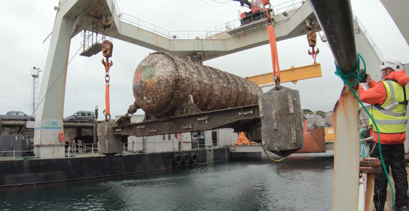 The <em>Northern Isles</em>, a 12-rack / 864-server underwater data center pod, is winched off the seafloor in this picture after its two-year trial deployment.