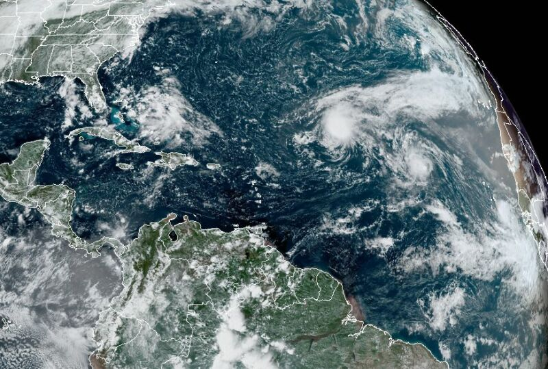 A satellite image of the state of play Thursday across the tropics.