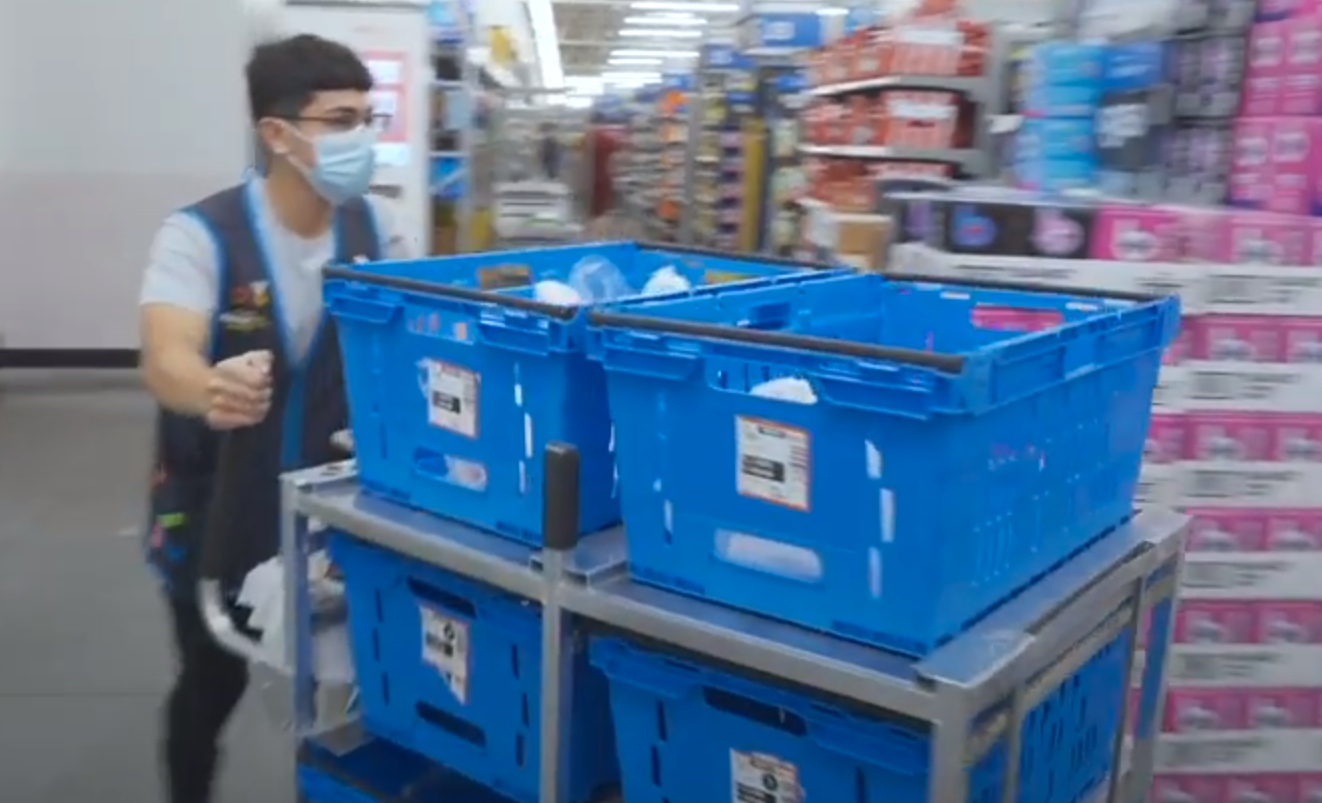 Most Walmart+ orders will be fulfilled directly from a local store—in this scene from a promotional video, a staffer picks products directly from shelves for delivery.