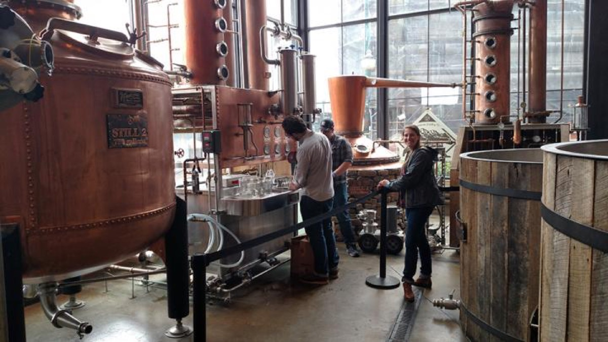 UT Department of Food Science graduate students collecting whiskey distillate samples for chemical analysis at the Sugarlands Distilling Company in Gatlinburg, Tennessee.